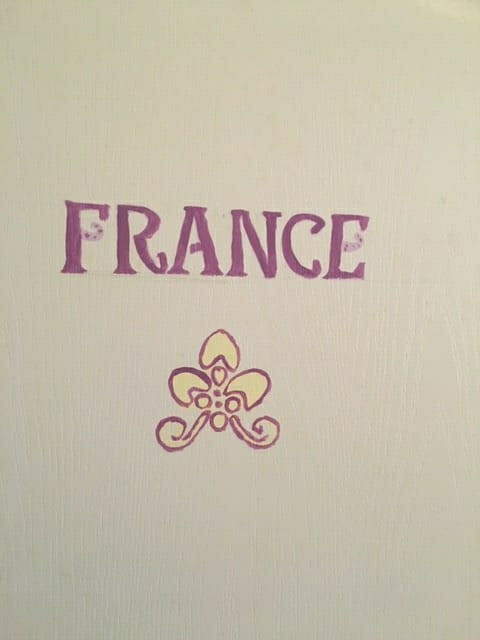 Image of a door with France painted on it.