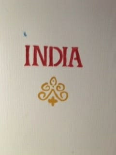Image of a door with India painted on it.
