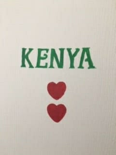 Image of a door with Kenya and 2 hearts painted on it.