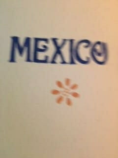 Image of a door with Mexico painted on it.