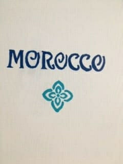 Image of a door with Morocco painted on it.