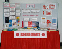Image of the CARE Red Ribbon Week display table.
